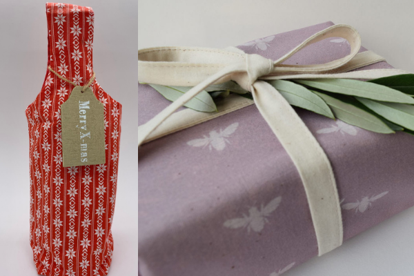 Reusable Christmas wine bottle gift bag and a gift wrapped in reusable cloth wrapping.