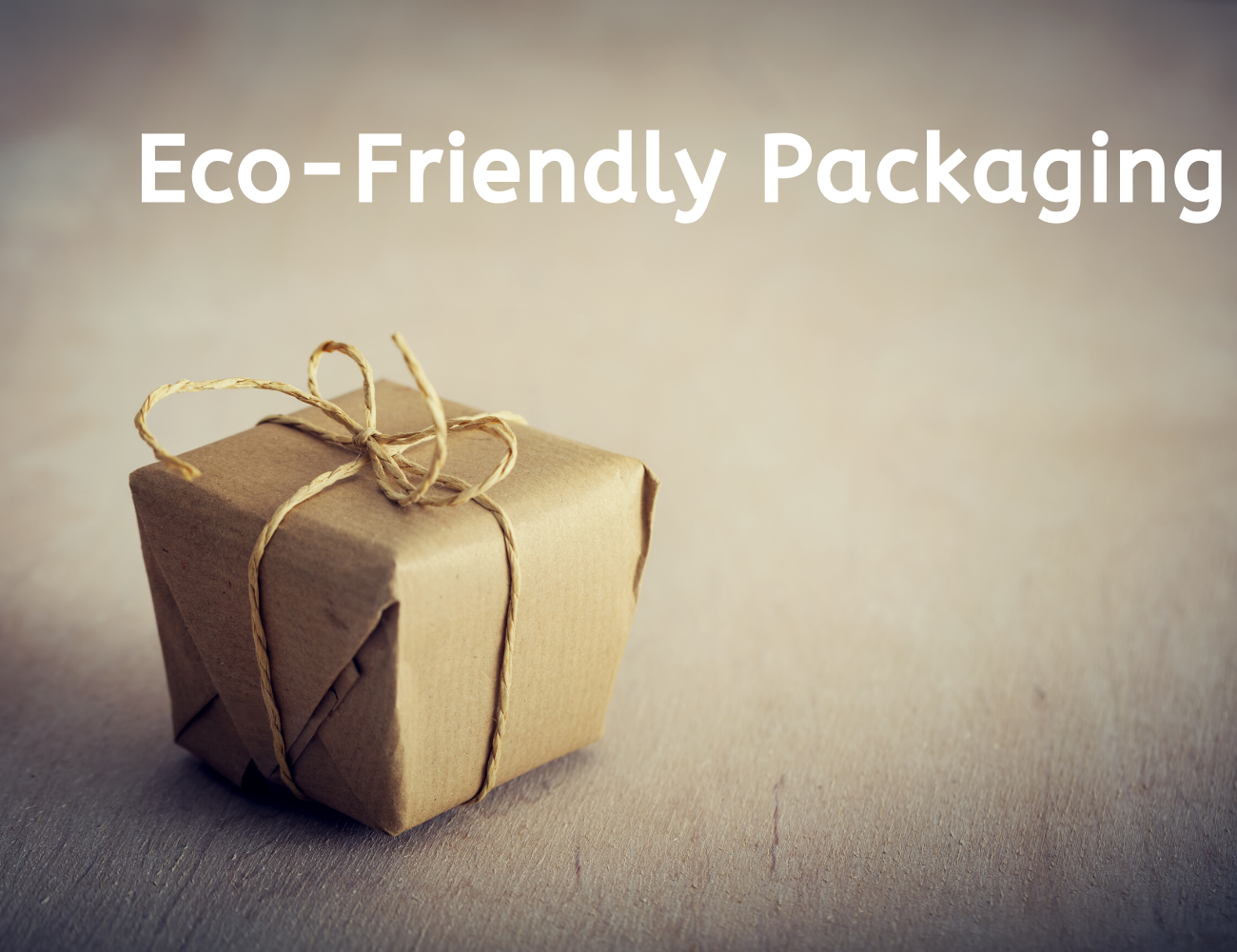 """Parcel wrapped in brown paper and tied with natural twine next to the words """"Eco-friendly packaging""""."""