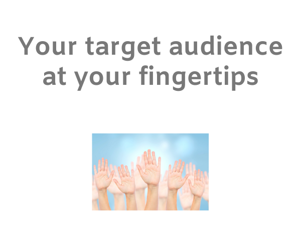 Arms of a crowd of people reaching upwards with the words 'your target audience at your fingertips' on a white background.