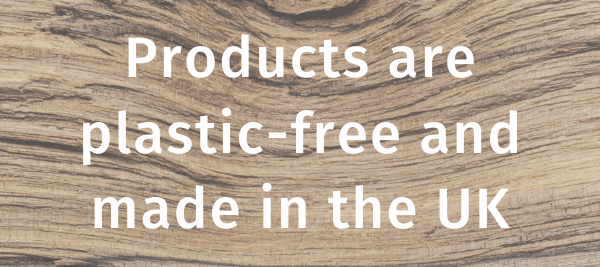 "The words ""Products are plastic free and made in the UK"" written in white on a wooden background."